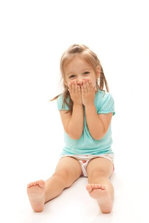 Young girl laughing to the camera on isolated white background.