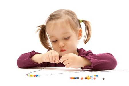 Young little girl beading on isolated white background