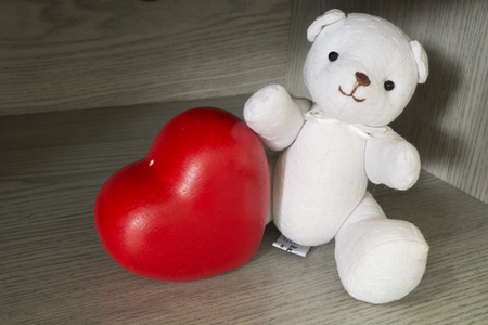 white bear: White bear with heart  in small room Stock Photo