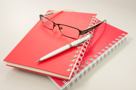 eye glasses with notebook and pen on table Stock Photo