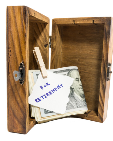Retirement concept with money box photo