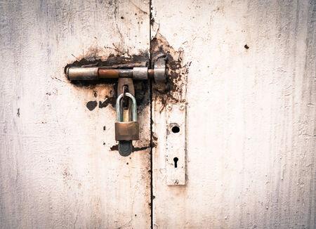 Old door locked Stock Photo - 29174751