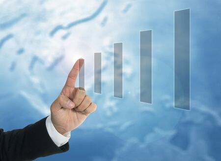 business chart concept with bar chart and hand of business man