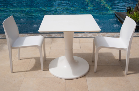 Table and Chair near swimming pool