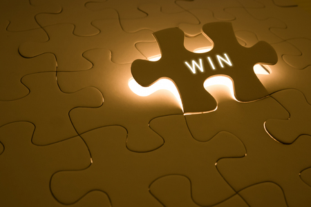 success concept with win word on puzzle Stock Photo
