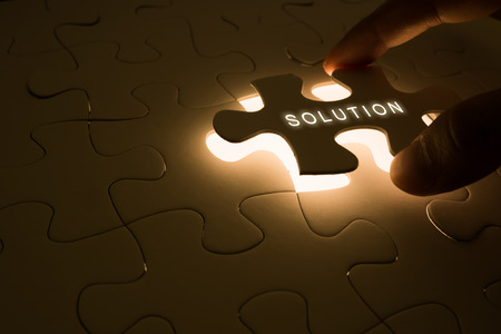 closeup puzzle with solution concept of business