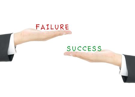 Success vs Failure on hand of business man