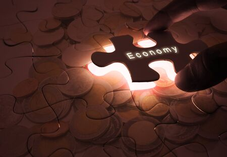 Economy Global Business with Puzzle Coins Stock Photo