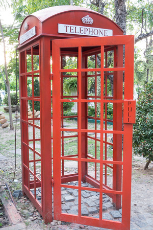Traditional old style UK red phone box in Thailand