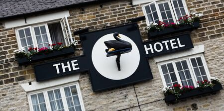 Helmsley, North Yorkshire, Engalnd, June 24, 2010: The unique sign on the front of the historic Black Swan Hotel.