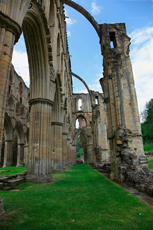 Roofless walls of bricks and columns are all that remain of Rievaulx Abbey which are still standing tall after more than eight hundred years.