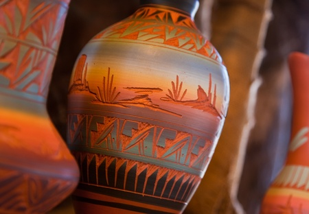 Very colorful Native American Pottery is lit from the side by moring light. Stock Photo
