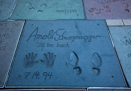 Hollywood, CA - January 19: Arnold Schwarzeneggers hand and foot prints in the sidewalk infront of Graumans Chinese Theater in Hollywood, California 2011.
