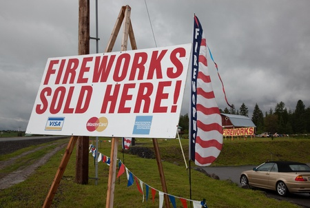 indian creek: Coeur dAlene Tribal Reservation, Fighting Creek, Idaho - June 13, 2011: Theree fireworks signs, visable from Highway 95, beckon potential buyers to stop and buy fireworks for the Fourth of July at Fighting Creek, Idaho.
