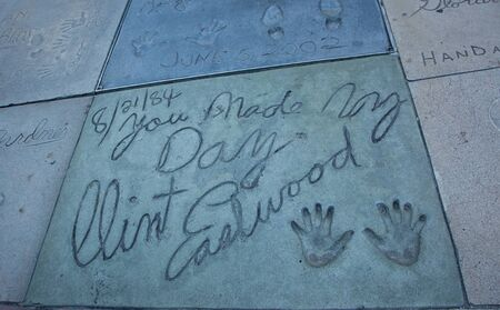 Hollywood, CA - January 19: Clint Eastwoods hand and foot prints in the sidewalk infront of Graumans Chinese Theater in Hollywood, California 2011.