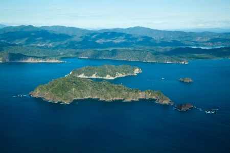 An ariel view of blue ocean water and Tortugas Islands in the Gulf of Nicoya, Costa Rica, Central America. Stock Photo