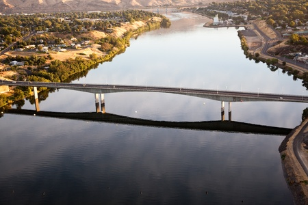 An early morning areal view from a hot air balloon of the Southway Bridge over the Snake River with Clarkston Washington on the left, and Lewiston Idaho on the right. photo