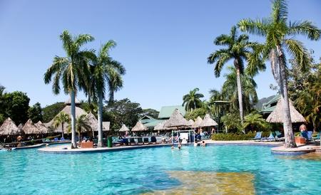 Tambor Resort, Costa Rica - January 9: Tourist enjoying a warm bright sunny day in and around the pool at Tambor Resort, Costa Rica.