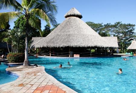 Tambor Resort, Costa Rica - January 14: Tourist enjoying a warm bright sunny day in and around the pool at Tambor Resort, Costa Rica.