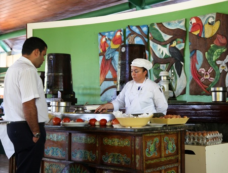 Tambor Resort, Costa Rica - January 14: A chef prepares a custom omelet for an employee at her breakfast station at Tambor Resort, Costa Rica.