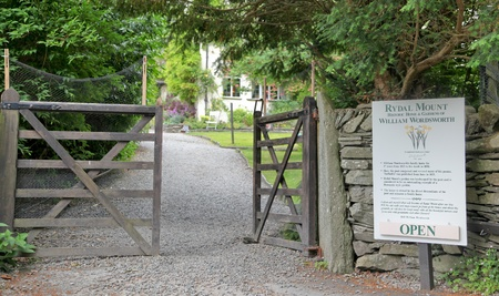 lake district england: Ambleside, Lake District, England - June 21: A sign next to a driveway with a half open gate leading into Rydal Mount, home of William Wordsworth in Ambleside, Lake District, England.