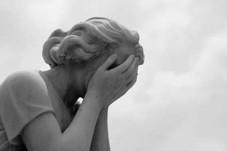 The grief of losing a loved one is captured in a marble statue of a woman crying into her hands