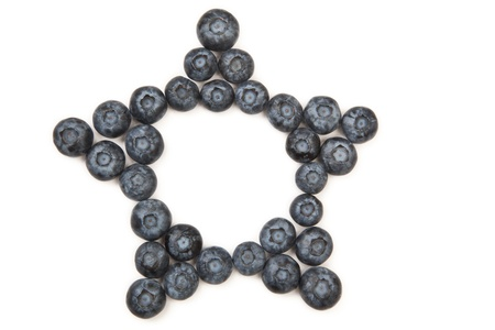 five star: Organic blueberries arranged in a five sided star pattern frame isolated on white.