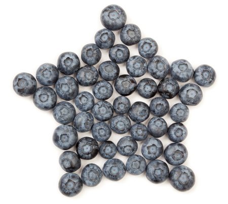 five star: Organic blueberries arranged in a five sided star pattern isolated on white. Stock Photo