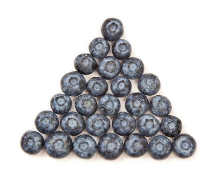 food pyramid: Organic blueberries arranged in a pyramid pattern isolated on white.