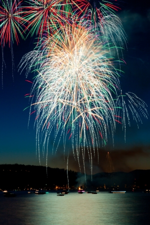 Fourth of July fireworks exploding and then cascading down to the boats on Lake Coeur d photo