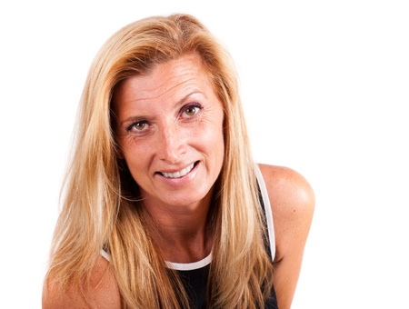 fortysomething: Portrait of a smiling  forty-something year old blonde woman with   natural skin and and well earned wrinkles isolated on white  Stock Photo