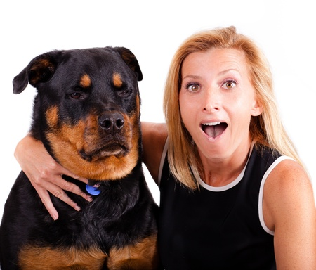 Self portrait of a blonde woman with an excited expression and her dog who is not so excited  photo