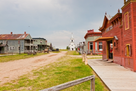 Looking down main street of an old western town on the prarie.