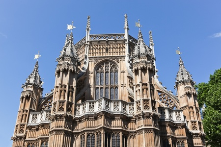 A close up of the architectural details and spires of Westminster Abby in London, England.