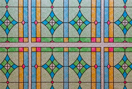 diamond shape: A background of a stained glass window pattern with a variety of colors and shapes. Stock Photo
