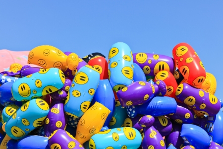 blowup: Blowup toys in bright colors with yellow smiley faces on them at the North Idaho Fair with a blue sky background.