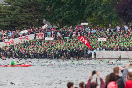 COEUR D ALENE, ID - JUNE 23:   Swimmers going into the water and in the holding area at the start of the June 23, 2013 Ironman Triathlon in Coeur dAlene, Idaho.