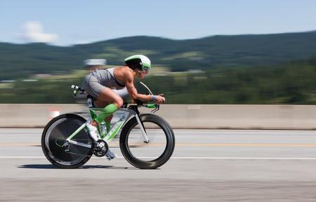 COEUR D ALENE, ID - JUNE 23: Trish Diem on bike  at the June 23, 2013 Ironman Triathlon in Coeur d'Alene, Idaho.