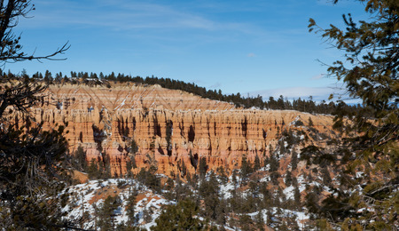 Colorful layers of eroded sandstone create columns along a cliff in Bryce Canyon National Park, Utah. photo