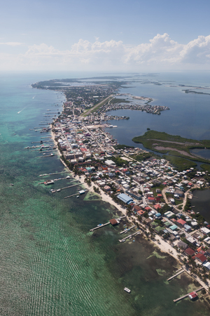 San Pedro town on Ambergris Caye, Belize in the Caribbean as seen from the air with calm waters provided by the protective offshore coral reef. photo
