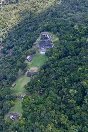 The Mayan Temple of Xunantunich located in the Cayo District of Belize as seen from the air   Jungle is encroaching on the ancient site  photo