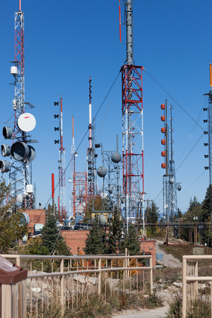 Sandia Crest, NM, October 2, 2014: Large metal towers holding up various types of cones and dishes to relay electronics on top of Sandia Crest in New Mexico on October 2nd, 2014. Editoriali