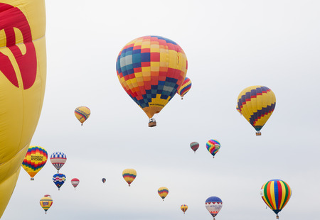 Albuquerque, NM, October 8: Several colorful hot air balloons take to the air at the Balloon Fiesta in Albuquerque, New Mexico on October 8th, 2014. Editorial
