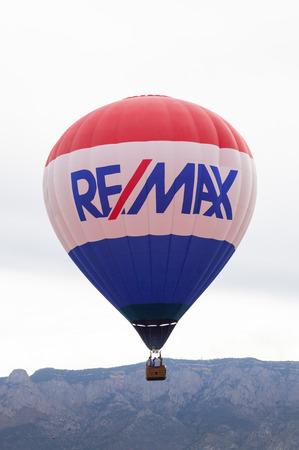 Albuquerque, NM, October 8:  The Remax balloon floating near the Sandia Mountains at the Balloon Fiesta in Albuquerque, New Mexico on October 8th, 2014. Editoriali