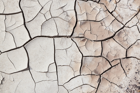 pealing: A close up view of dry cracked earth with layers pealing back and small pebbles. Stock Photo