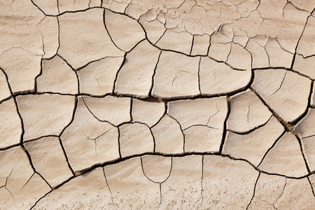 A background of dry cracked mud in the sunshine at Badlands National Park in South Dakota.