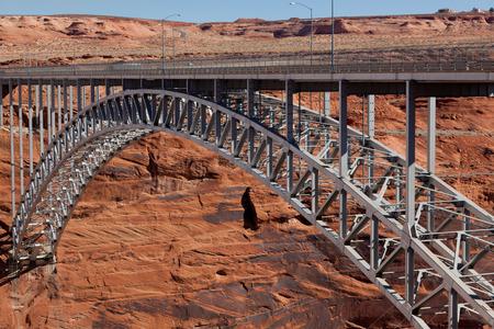 colorado river: The Glen Canyon Dam Bridge arching across the red rock above the Colorado River in Page, Arizona. Stock Photo