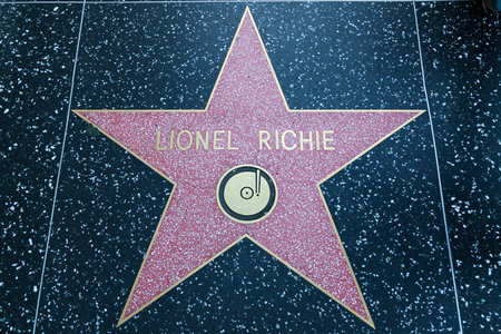 famous industries: HOLLYWOOD, CALIFORNIA - February 8 2015: Lionel Richies Hollywood Walk of Fame star on February 8, 2015 in Hollywood, CA. Editorial