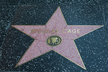famous industries: HOLLYWOOD, CALIFORNIA - February 8 2015: Nicolas Cages Hollywood Walk of Fame star on February 8, 2015 in Hollywood, CA. Editorial