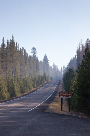 The north entrance going into Crater Lake with smoke from a forest fire causing a hazardous condition.